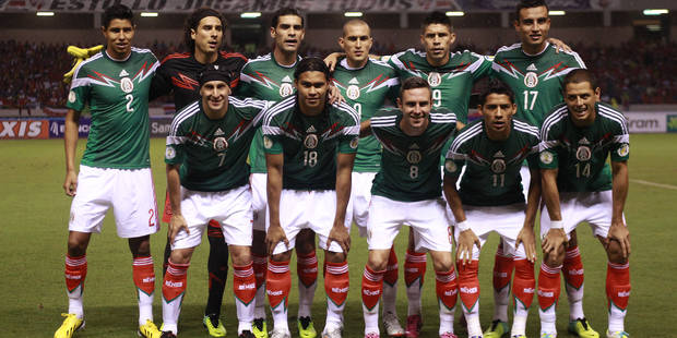 FILE- In this Oct. 15, 2013 file photo, Mexico's team poses prior to the start the 2014 World Cup qualifying soccer match between Costa Rica and Mexico, in San Jose, Costa Rica. Background from left: Hugo Ayala, Guillermo Ochoa, Rafael Marquez, Jorge Torres, Oribe Peralta, Jesus Zavala. Foreground from left, Christian Gimenez, Carlos Pena, Miguel Layun, Javier Aquino and Javier Hernandez. The draw for the 2014 World Cup finals takes place Friday Dec. 6, 2013 near Salvador, Brazil. The 32 teams will be drawn into eight groups of four. The top two in each group will progress to the knockout stages. Twelve stadiums in twelve cities will host matches. (AP Photo/Fernando Vergara, File)  Associated Press / Reporters