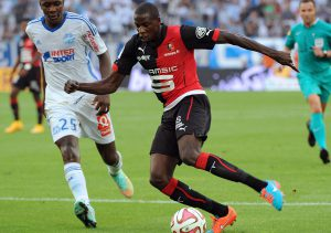 Marseille's French midfielder Giannelli Imbula (L) vies with Rennes'  midfilder Rennes' French midfielder Abdoulaye Doucoure  (R)  during their French L1 football match between Olympique of Marseille (OM) amd Rennes at the Velodrome stadium in Marseille, on September 20, 2014.    AFP PHOTO / BORIS HORVAT        (Photo credit should read BORIS HORVAT/AFP/Getty Images)