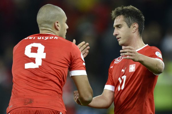 Swiss forward Mario Gavranovic, right, reacts with Swiss forward Eren Derdiyok, left, after the FIFA World Cup 2012 group E qualifying soccer match between Switzerland and Norway at the Stade de Suisse stadium, in Bern, Switzerland, Friday, October 12, 2012. (KEYSTONE/Laurent Gillieron)