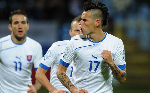 Slovakia's Marek Hamsik (R) celebrates his goal with Marek Sapara (C) and Marek Bakos (L) during the FIFA 2014 World Cup qualifier football match Slovakia vs Latvia in Bratislava on October 12, 2012. AFP PHOTO / SAMUEL KUBANI (Photo credit should read SAMUEL KUBANI/AFP/GettyImages)