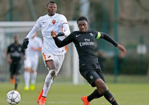 """POISSY, FRANCE - MARCH 09:  Mamadou Doucoure of PSG battles for the ball with Sadiq Umar of Roma during the UEFA Youth League Quarter-final match between Paris Saint Germain and AS Roma at Stade Georges-Lefevre on March 9, 2016 in Poissy, France.  (Photo by Dean Mouhtaropoulos/Getty Images)"""