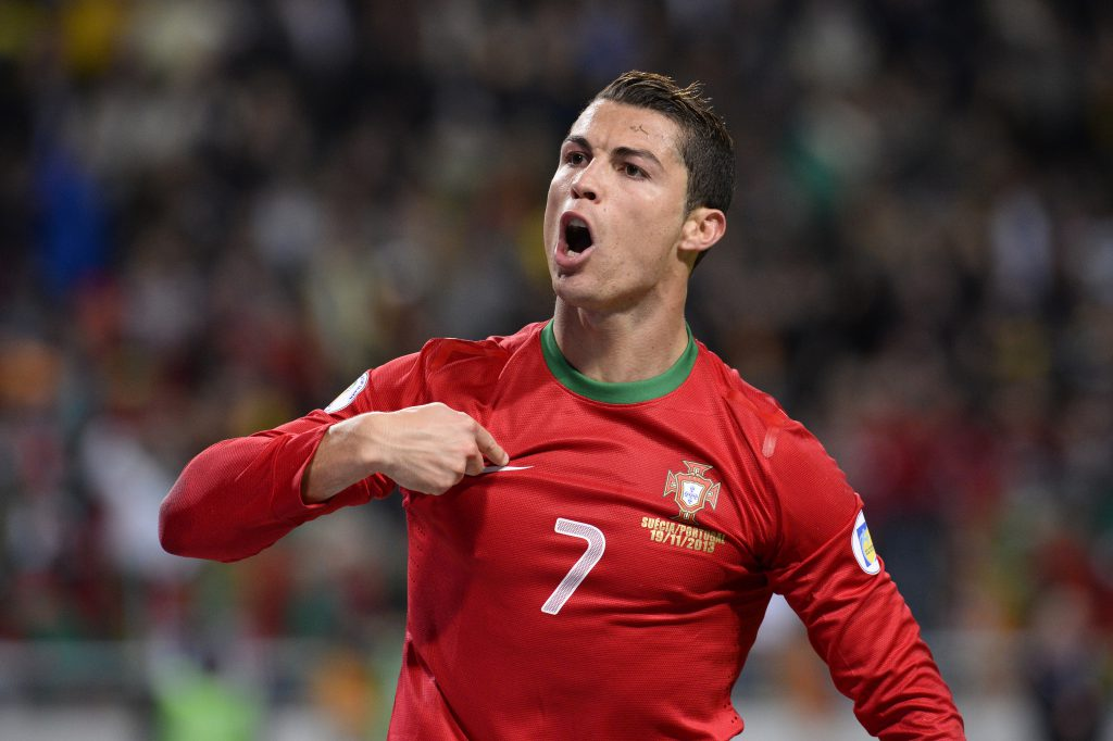 Portugal's forward Cristiano Ronaldo celebrates after scoring the second goal for Portugal during the FIFA 2014 World Cup playoff football match Sweden vs Portugal at the Friends Arena in Solna near Stockholm on November 19, 2013 . AFP PHOTO/ JONATHAN NACKSTRAND        (Photo credit should read JONATHAN NACKSTRAND/AFP/Getty Images)