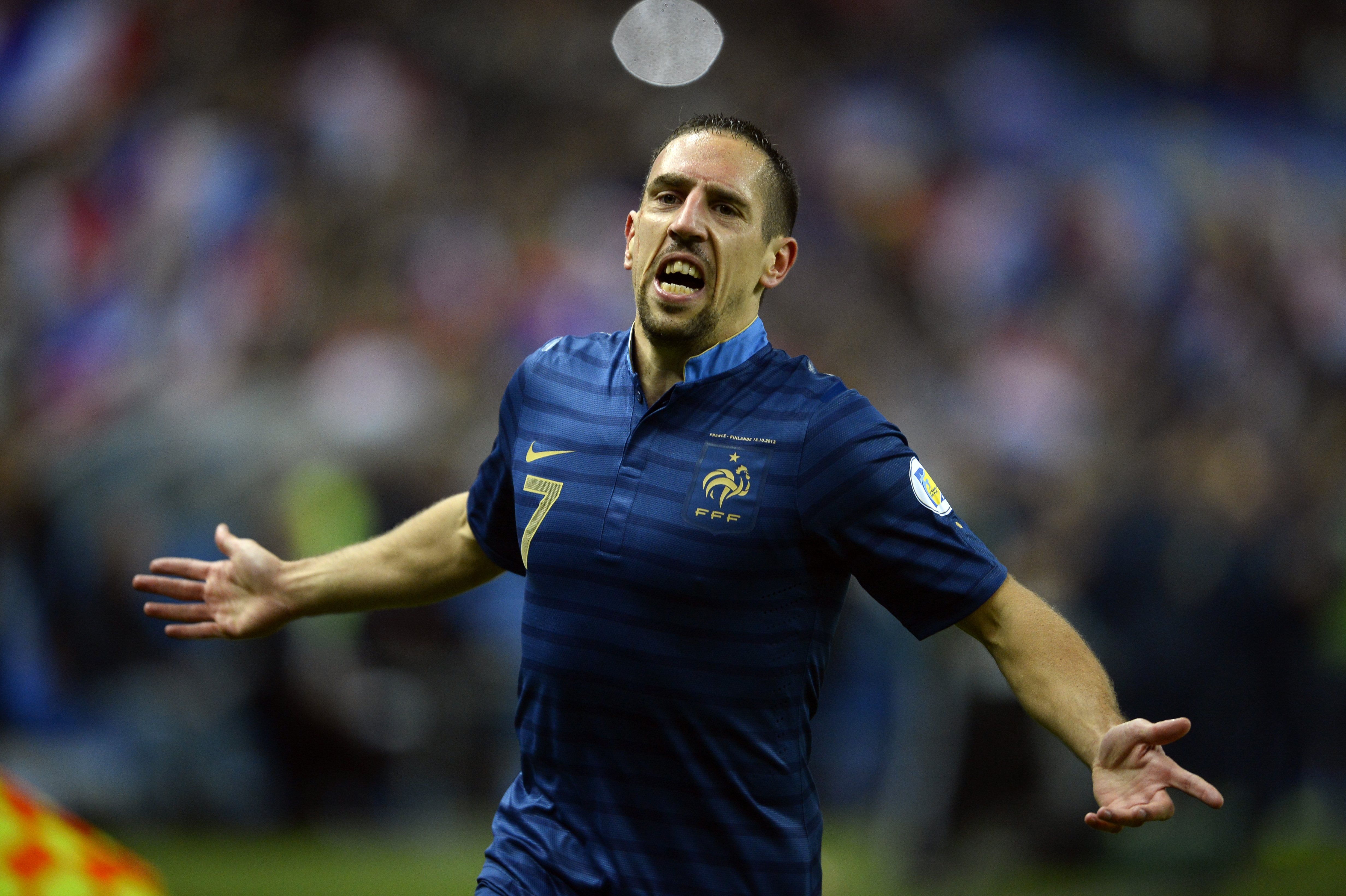 France's midfielder Franck Ribery celebrates after scoring a goal during the 2014 FIFA World Cup qualifying group I football match between France and Finland at the Stade de France in Saint-Denis, north of Paris, on October 15, 2013. AFP PHOTO / LIONEL BONAVENTURE