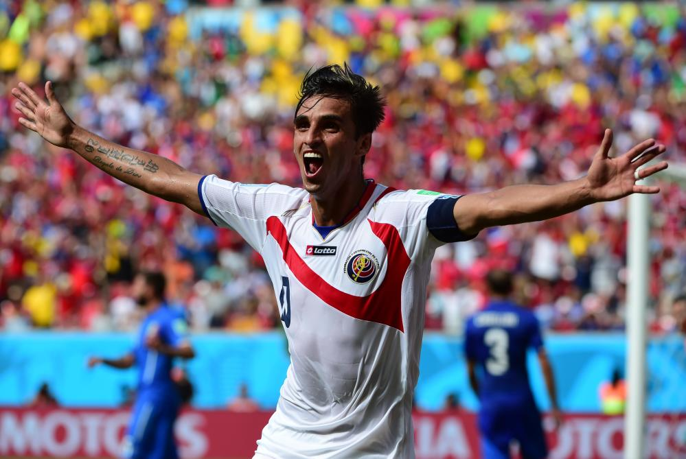 Costa Rica's forward Bryan Ruiz celebrates after scoring his team's first goal during a Group D match between Italy and Costa Rica at the Pernambuco Arena in Recife during the 2014 FIFA World Cup on June 20, 2014. AFP PHOTO / RONALDO SCHEMIDT