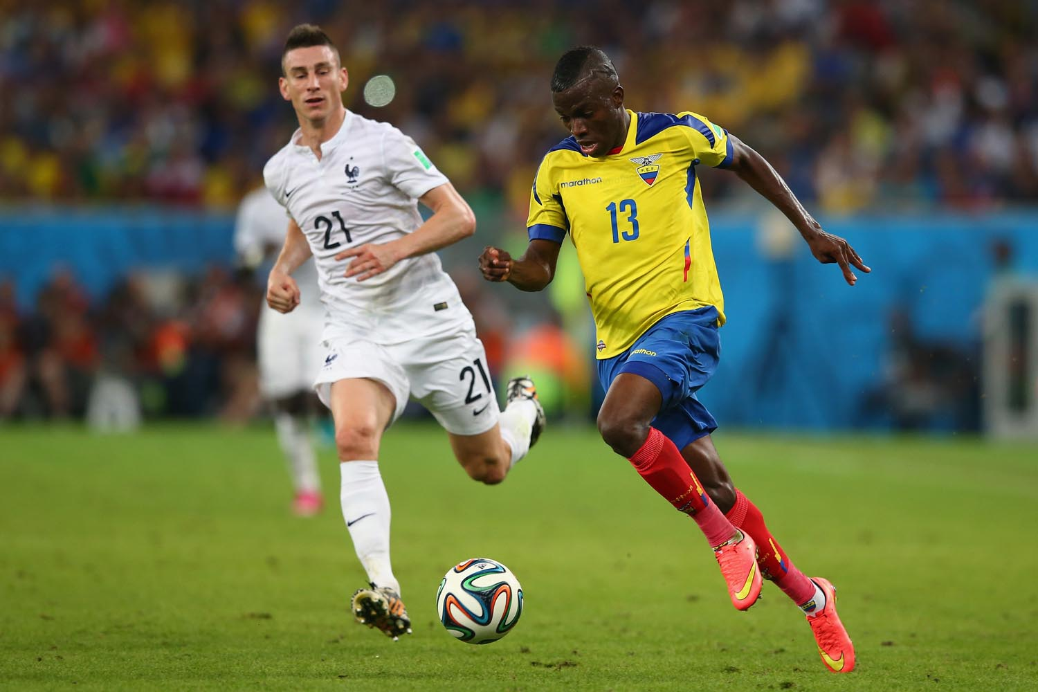 RIO DE JANEIRO, BRAZIL - JUNE 25: Enner Valencia of Ecuador controls the ball against Laurent Koscielny of France during the 2014 FIFA World Cup Brazil Group E match between Ecuador and France at Maracana on June 25, 2014 in Rio de Janeiro, Brazil. (Photo by Julian Finney/Getty Images)