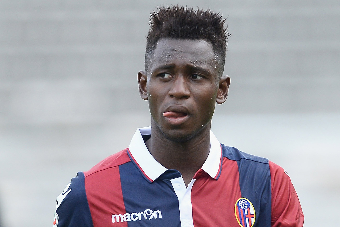 BOLOGNA, ITALY - SEPTEMBER 27: Amadou Diawara # 21 of Bologna FC looks dejected at the end of the Serie A match between Bologna FC and Udinese Calcio at Stadio Renato Dall'Ara on September 27, 2015 in Bologna, Italy. (Photo by Mario Carlini / Iguana Press/Getty Images)