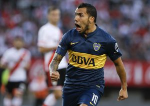 Carlos Tevez of Boca Juniors celebrates a goal scored by teammate Nicolas Lodeiro against River Plate during a local tournament soccer match in Buenos Aires, Argentina, Sunday, Sept. 13, 2015.(AP Photo/Natacha Pisarenko)