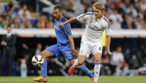 Real Madrid's Martin Odegaard from Norway, right, duels for the ball with Getafe's Lacen, during a Spanish La Liga soccer match between Real Madrid and Getafe at the Santiago Bernabeu stadium in Madrid, Spain, Saturday, May 23, 2015. (AP Photo/Daniel Ochoa de Olza)