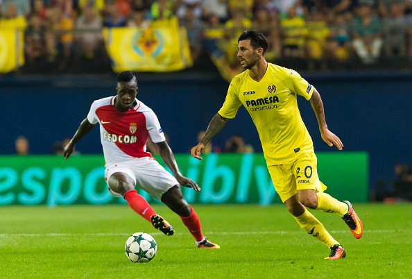 Roberto Soriano of Villarreal CF and Benjamin Mendy of AS Monaco during the UEFA Champions league first leg play-off football match between Villarreal CF and AS Monaco at the Madrigal stadium in Vila-real on August 17, 2016. (Photo by Maria Jose Segovia/NurPhoto via Getty Images)