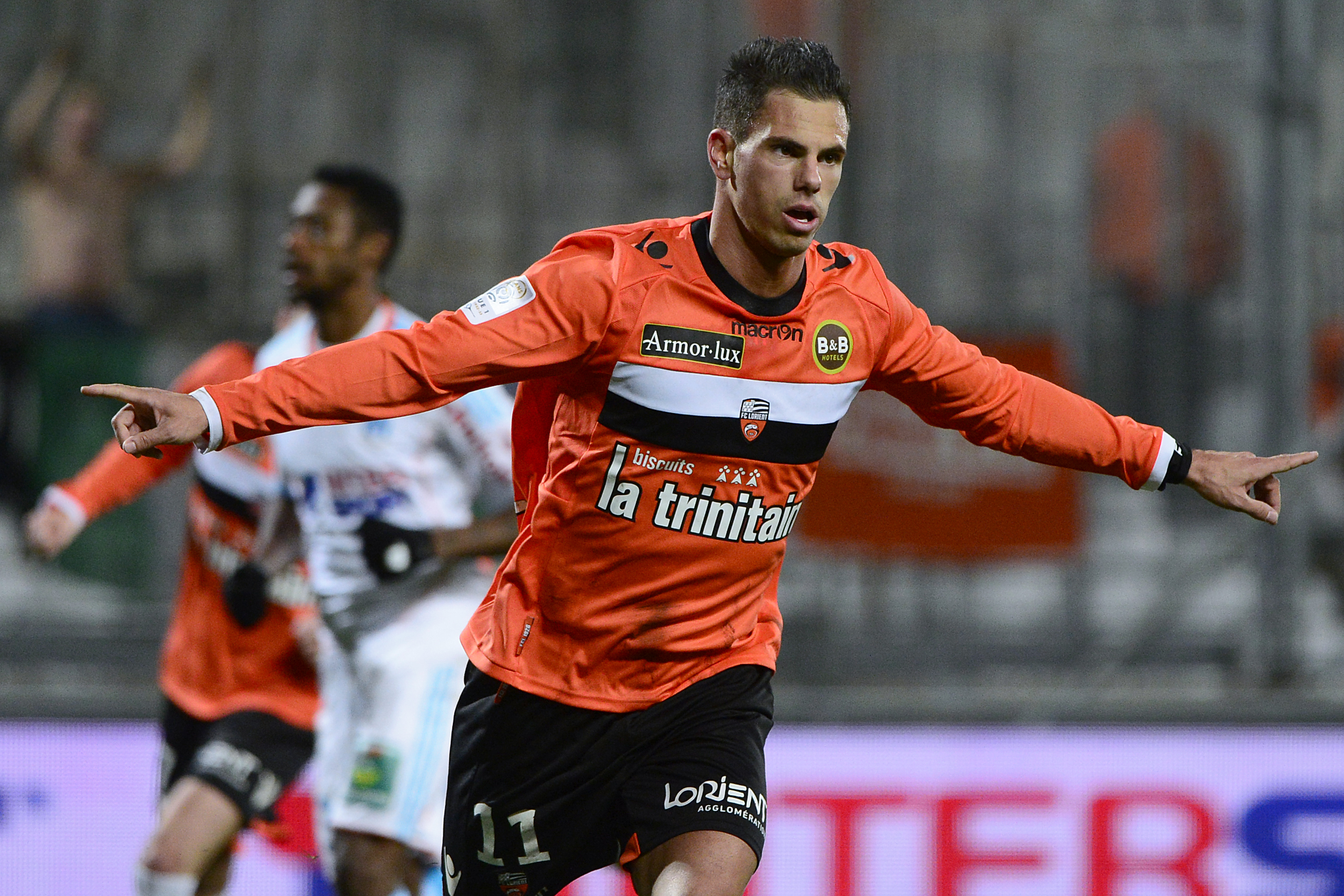 Lorient's French forward Jeremie Aliadiere celebrates after scoring during the French L1 football match between Olympique de Marseille (OM) and Lorient at the Velodrome stadium in Marseille on December 9, 2012. AFP PHOTO / BORIS HORVAT (Photo credit should read BORIS HORVAT/AFP/Getty Images)