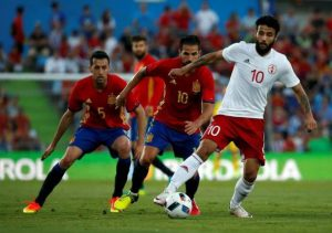 Football Soccer - Spain v Georgia- International Friendly- Colisseum Alfonso Perez, Getafe, Spain  - 07/06/16 - Georgia's Tornike Okriashvili controls the ball past Spain's Sergio Busquets and Cesc Fabregas. REUTERS/Susana Vera