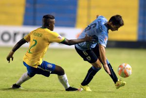 Kleber (L) of Brazil and Marcelo Saracchi of Uruguay vie during their U-17 South American final round football match, at Erico Galeano Stadium in Capiata, Paraguay, on March 23, 2015. AFP PHOTO / Norberto Duarte        (Photo credit should read NORBERTO DUARTE/AFP/Getty Images)