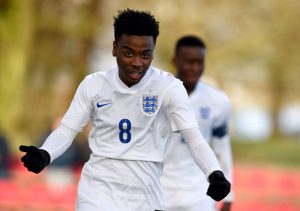 BURTON-UPON-TRENT, ENGLAND - FEBRUARY 18:  Angel Gomes of England celebrates after scoring during the England v Czech Republic  U16s International Friendly at St Georges Park on February 18, 2016 in Burton-upon-Trent, England.  (Photo by Ross Kinnaird/Getty Images)